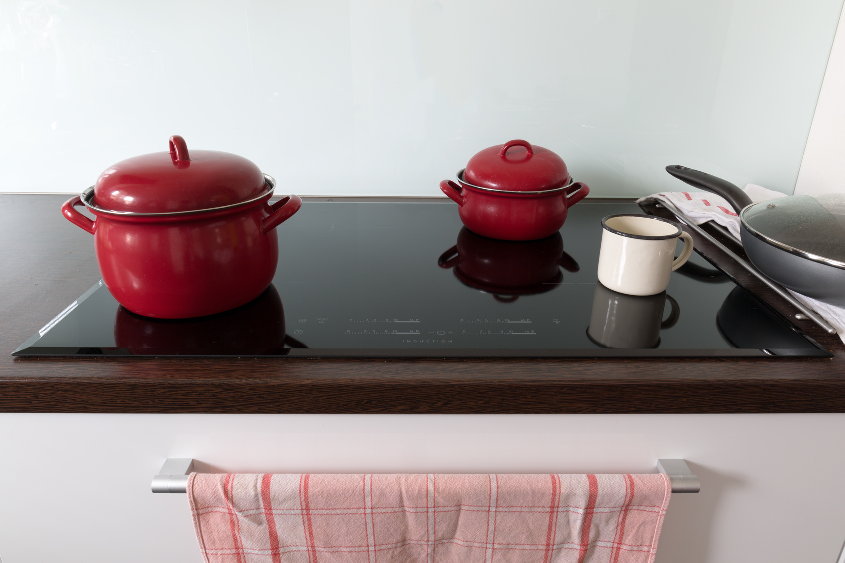 Cooking in red pots on induction hob